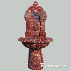 The Rosso Levanto marble wall fountain