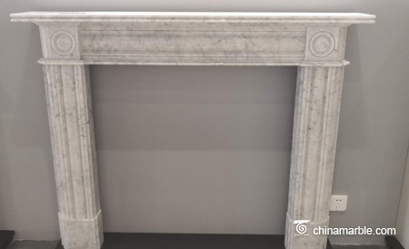 White Aegean limestone fireplace mantel