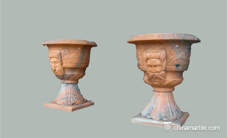 Planter-with-face-carving-